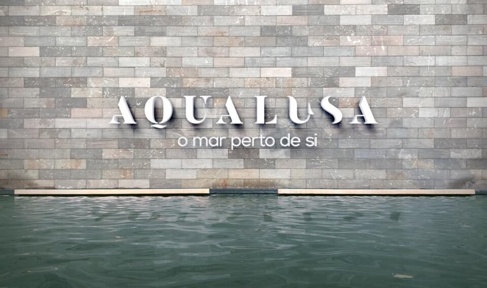 Simulação do logótipo da Aqualusa sobre uma parede