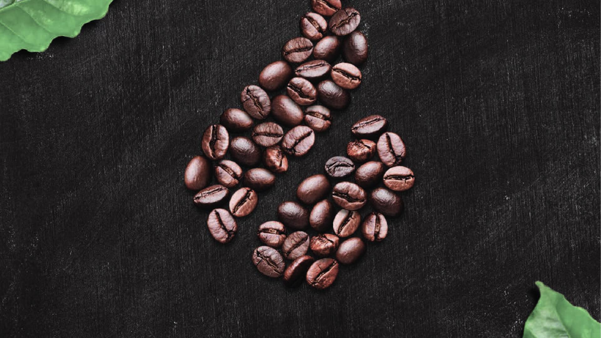 logótipo da marca Cafés Candelas com grãos de café