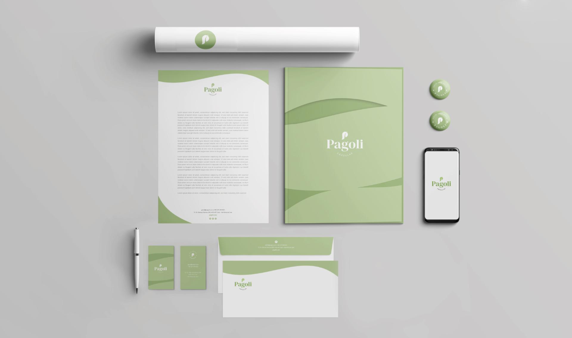 Estacionário da Pagoli com papel de carta, cartão de visita, envelope, capa de documentos, caneta e cápsulas